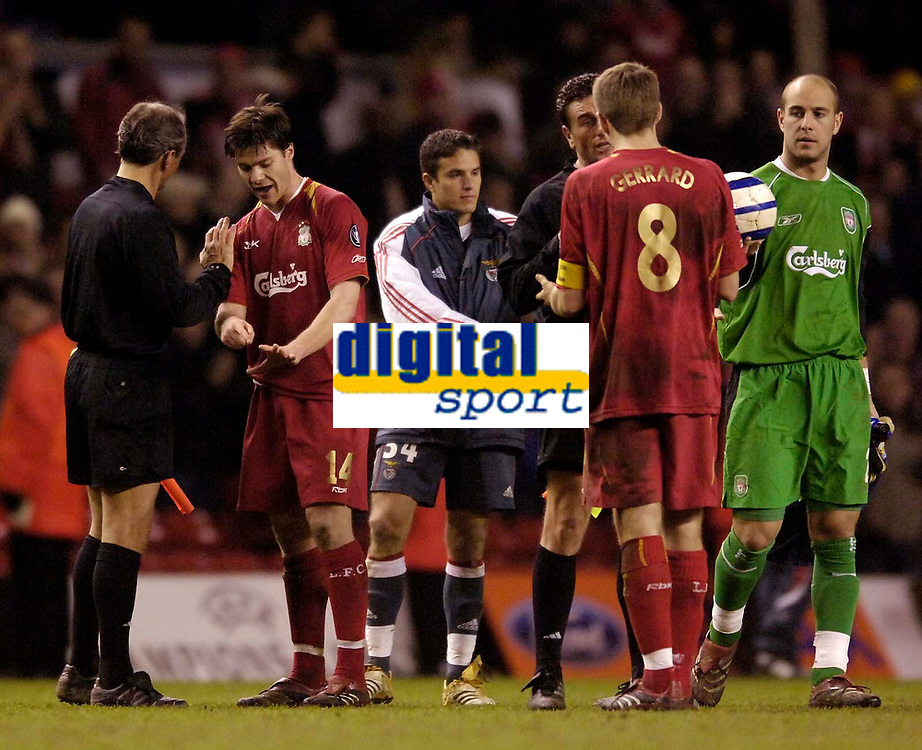 Photo: Jed Wee.<br /> Liverpool v Benfica. UEFA Champions League. 08/03/2006.<br /> <br /> Liverpool's Xabi Alonso (L) and Steven Gerrard make points to the match officials at the end of the game.