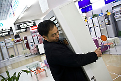 Store clark brings in new electronic products on sales floor in Chongqing , China, March 4, 2009.