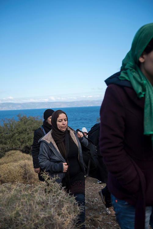 Having just landed on the beach in a small boat from Turkey, migrants from Syria and Iraq walk up toward a road on the Greek island of Lesbos. They are among more than 500,000 migrants and refugees who have crossed from Turkey to the Greek islands in 2015.