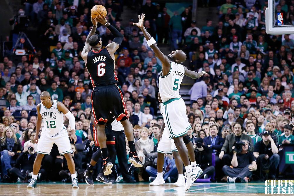 27 January 2013: Miami Heat small forward LeBron James (6) takes a jumpshot over Boston Celtics power forward Kevin Garnett (5) during the Boston Celtics 100-98  2OT victory over the Miami Heat at the TD Garden, Boston, Massachusetts, USA.