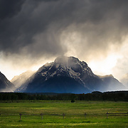 A spring evening thunderstorm travels along the Jackson Hole valley over Mount Moran in Grand Teton National Park, Wyoming.