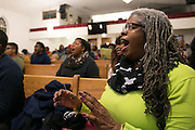 April Dixon of Rochester sings with the choir at a rehearsal for the 2017 Gospel Songfest in Rochester on Tuesday, January 10, 2017.
