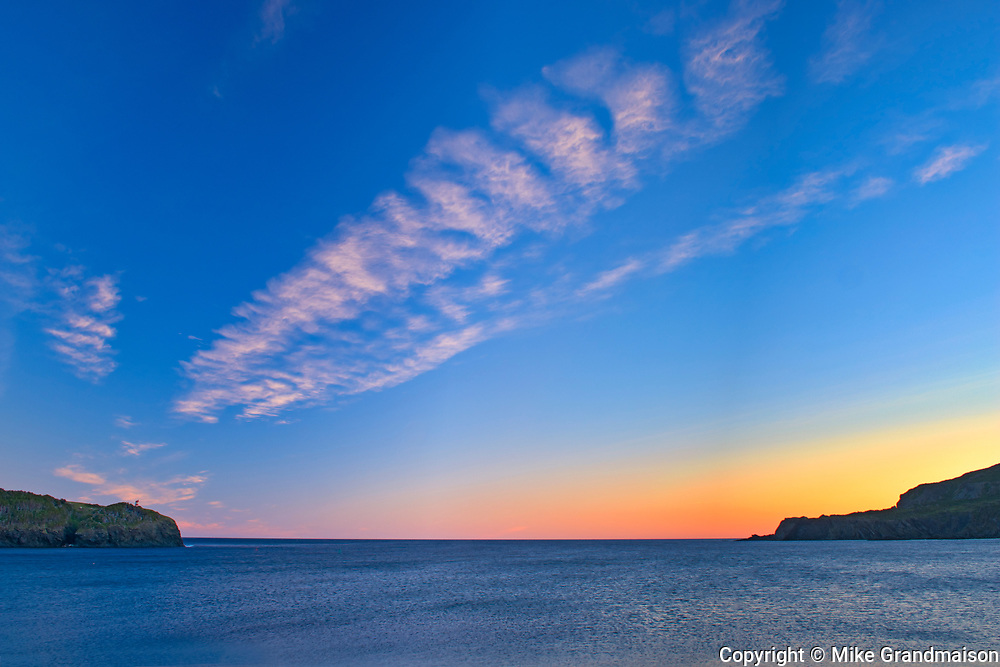 Clouds at sunrise on Trout River Bay<br />