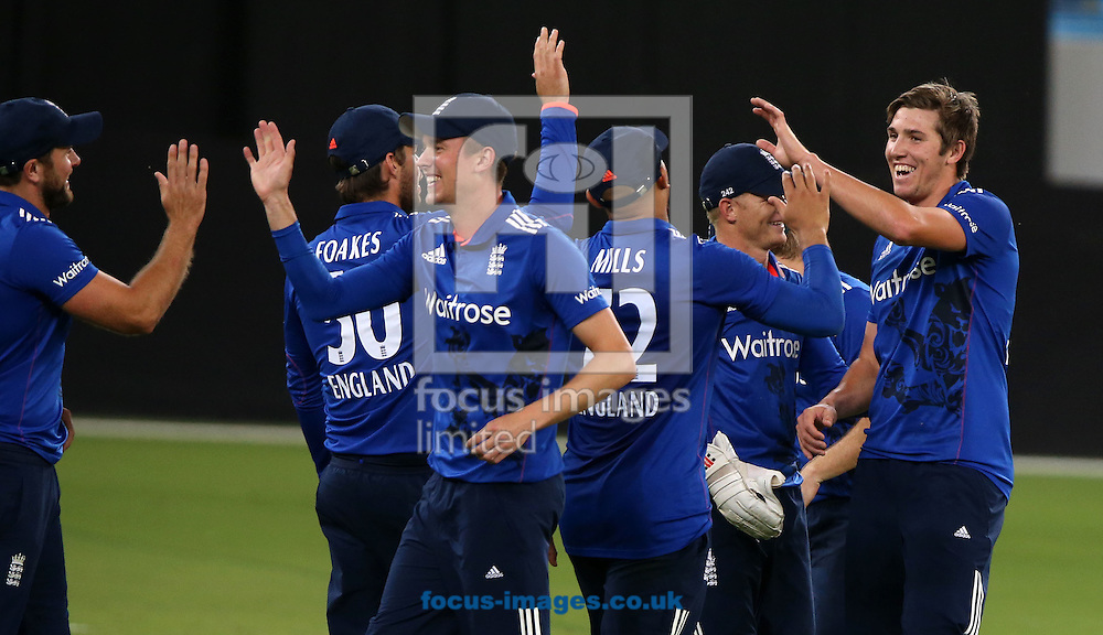 Jamie Overton of England Lions takes the wicket of Aamer Yamin of Pakistan A during the International Twenty/20 match at Dubai International Cricket Stadium, Dubai<br /> Picture by Chris Whiteoak-Medcalf/Focus Images Ltd +971 8117530<br /> 10/12/2015