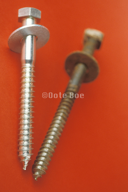 old and new screws with washers attached