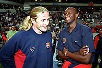 Patrick Vieira (Arsenal) and Emmanuel Petit (Barcelona) share a joke before the match. Arsenal v FC Barcelona, The Amsterdam Tournament, Amsterdam Arena, Holland, 3/8/2000. Credit Colorsport / Stuart MacFarlane.