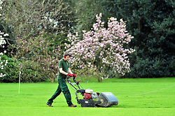 © Licensed to London News Pictures. 30/03/2017<br /> Greenwich Park grounds man cutting the cricket pitch.<br /> Sunny spring weather at Greenwich Park, Greenwich, London.<br /> Photo credit :Grant Falvey/LNP