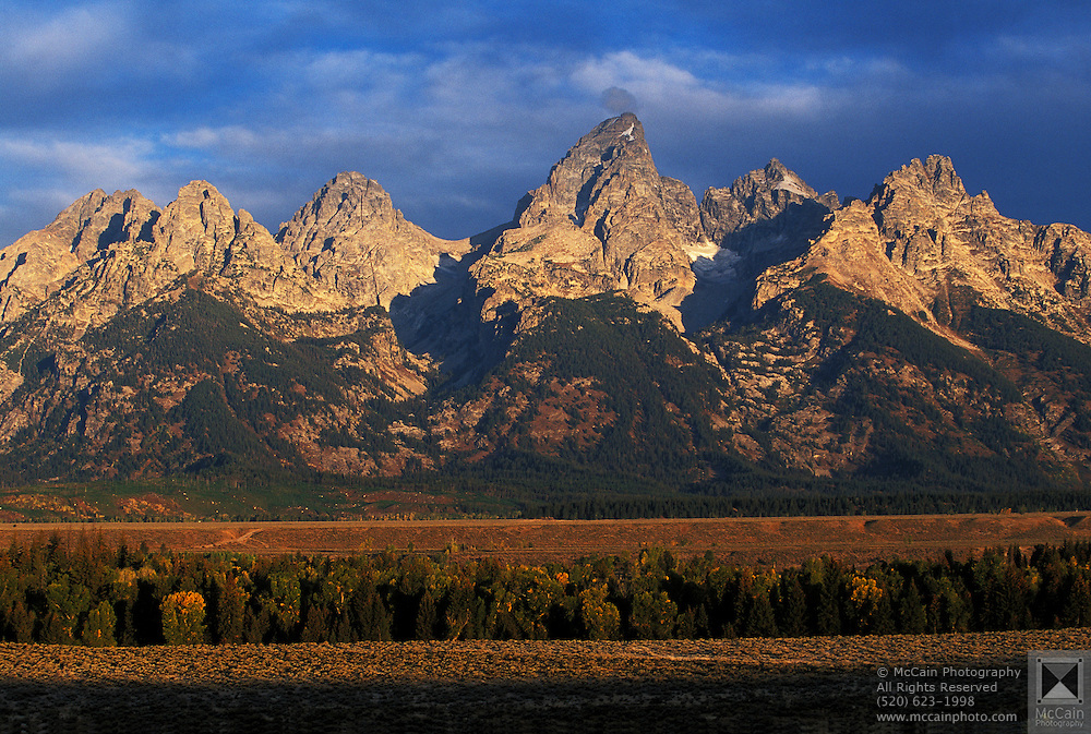 Teton Range at sunrise, Grand Teton Natl. Park, near Moose, WY..Subject photograph(s) are copyright Edward McCain. All rights are reserved except those specifically granted by Edward McCain in writing prior to publication...McCain Photography.211 S 4th Avenue.Tucson, AZ 85701-2103.(520) 623-1998.mobile: (520) 990-0999.fax: (520) 623-1190.http://www.mccainphoto.com.edward@mccainphoto.com