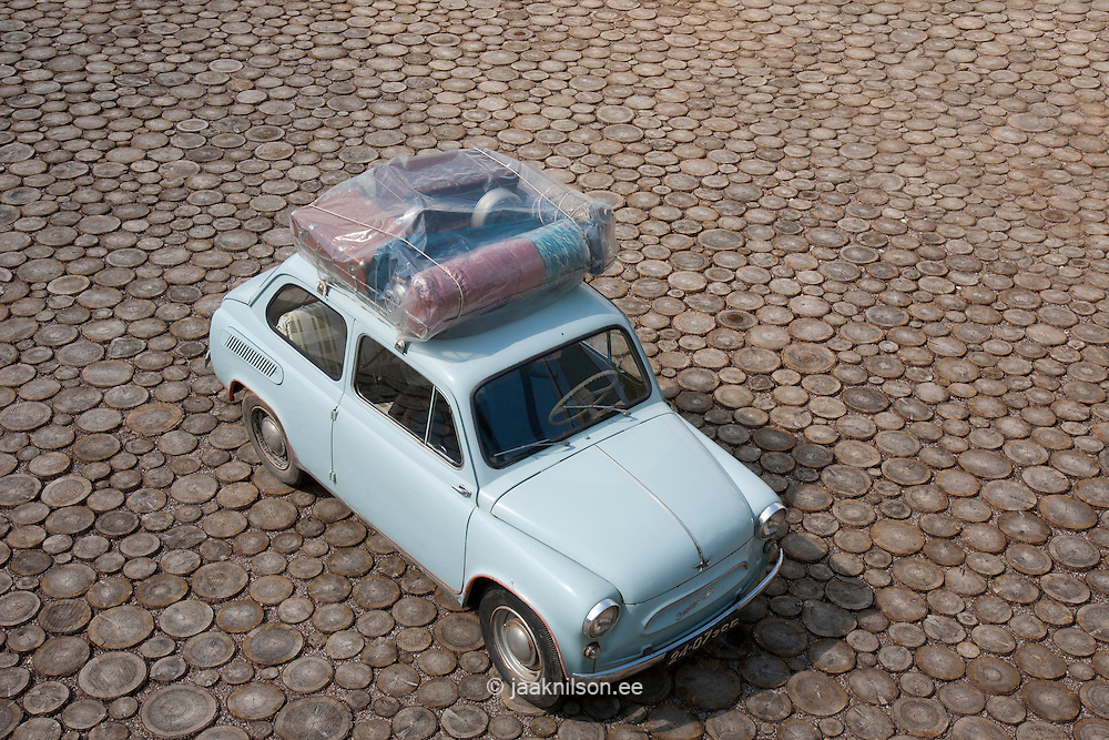Old car. Vehicle with baggage in Estonian Road Museum. Wooden floor.