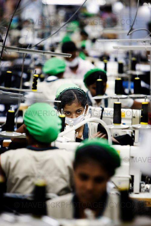 General views of a clothing factory in Colombo, Sri Lanka which manufactures goods for export to western markets. Pictured machine operators sew garments in the busy factory..