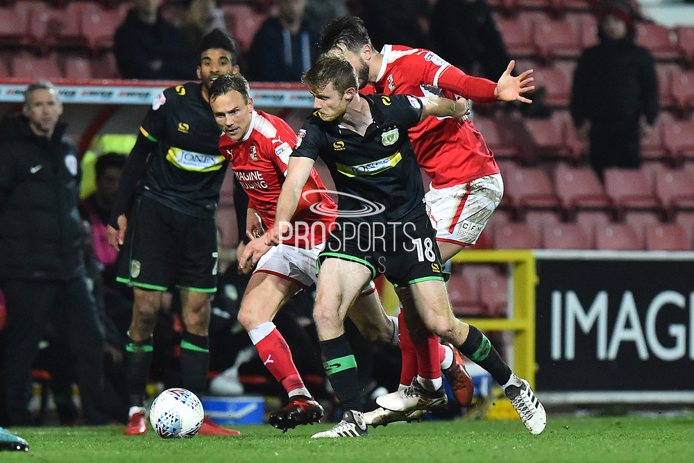 Alex Fisher (18) of Yeovil Town battles for possession during the EFL Sky Bet League 2 match between Swindon Town and Yeovil Town at the County Ground, Swindon, England on 10 April 2018. Picture by Graham Hunt.