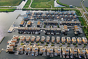 Nederland, Flevoland, Gemeente Almere, 27-08-2013; nieuwbouwwijk Noorderplassen-West met Zoneiland Almere. De zonnecollectoren op het eiland verwarmen water wat aan het stadswarmtenet wordt toegevoegd.<br /> Sun island (top right) in new constructed residential district in Almere providing city heating by solar panels.<br /> luchtfoto (toeslag op standaard tarieven);<br /> aerial photo (additional fee required);<br /> copyright foto/photo Siebe Swart.