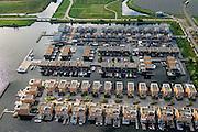 Nederland, Flevoland, Gemeente Almere, 27-08-2013; nieuwbouwwijk Noorderplassen-West met Zoneiland Almere. De zonnecollectoren op het eiland verwarmen water wat aan het stadswarmtenet wordt toegevoegd.<br /> Sun island (top right) in new constructed residential district in Almere providing city heating by solar panels.<br /> luchtfoto (toeslag op standaard tarieven);<br /> aerial photo (additional fee required);<br /> copyright foto/photo Siebe Swart.