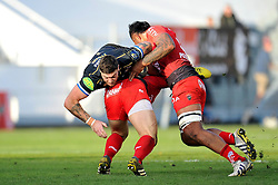 Matt Banahan of Bath Rugby is tackled in possession - Mandatory byline: Patrick Khachfe/JMP - 07966 386802 - 10/01/2016 - RUGBY UNION - Stade Mayol - Toulon, France - RC Toulon v Bath Rugby - European Rugby Champions Cup.