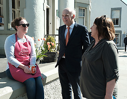 In front of the iconic Forth Rail Bridge, Liberal Democrat leader Vince Cable, former Change UK lead candidate David MacDonald, Lib Dem European election candidates and party activists unveiled a new election poster calling on Remain voters to unite to stop Brexit.<br /> <br /> Pictured: Sir Vince Cable MP and Christine Jardine MP chat to a local shop owner <br /> <br /> Alex Todd | Edinburgh Elite media