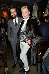Left to right, JACK GUINNESS and HENRY CONWAY at the launch of Korean restaurant Jinjuu with chef Judy Joo at 15 Kingley Street, London on 22nd January 2015.