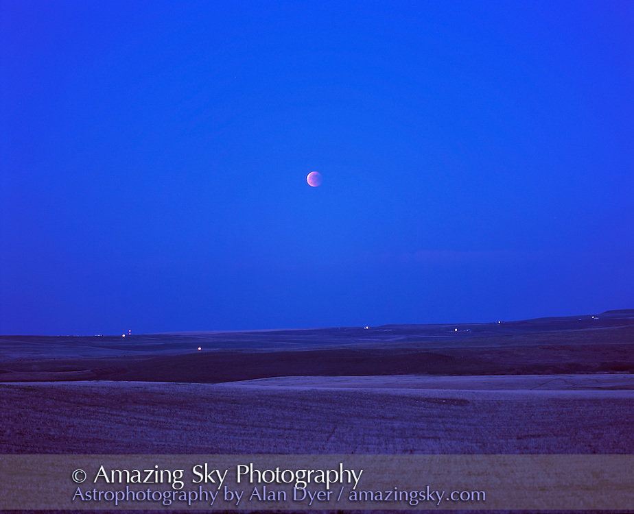 Total Eclipse of the Moon seen May 15, 2003 from southern Alberta (from a site west of Nanton). <br /> <br /> Moon rose as totality started so was deep into totality by the time it was high enough to see and sky dark enough to make it stand out. <br /> <br /> Pentax 67 camera with 165mm lens at f/2.8 with Fujicjrome 100f slide film. Fixed tripod.<br /> <br /> Scanned with Nikon 8000ED with Digital ICE and SuperFine Scan on for band and dust elimination.