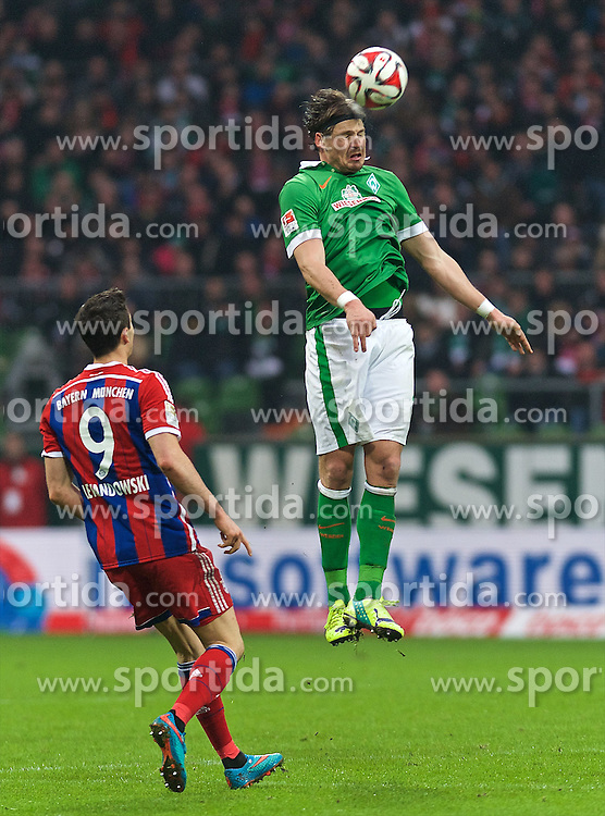 14.03.2015, Weserstadion, Bremen, GER, 1. FBL, SV Werder Bremen vs FC Bayern Muenchen, 25. Runde, im Bild Sebastian Proedl / Pr&ouml;dl (SV Werder Bremen #15) beim Kopfball, daneben Robert Lewandowski (FC Bayern Muenchen / M&uuml;nchen #9) // during the German Bundesliga 25th round match between SV Werder Bremen and FC Bayern Munich at the Weserstadion in Bremen, Germany on 2015/03/14. EXPA Pictures &copy; 2015, PhotoCredit: EXPA/ Andreas Gumz<br /> <br /> *****ATTENTION - OUT of GER*****