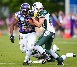 17.05.2015, Hohe Warte, Wien, AUT, BIG6, AFC Vienna Vikings vs Schwaebisch Hall Unicorns, im Bild Islaam Amadu (AFC Vienna Vikings, RB, #20), Cody Pastorino (Schwaebisch Hall Unicorns) und Jason Whitted (Schwaebisch Hall Unicorns) // during the BIG6 game between AFC Vienna Vikings vs Schwaebisch Hall Unicorns at the Hohe Warte, Wien, Austria on 2015/05/17. EXPA Pictures © 2015, PhotoCredit: EXPA/ Thomas Haumer