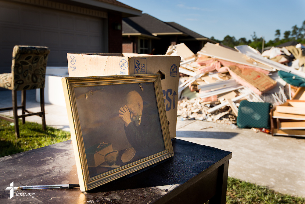 A torn picture is propped against damaged belongings outside the home of the Rev. Randy Blankschaen, pastor of Immanuel Lutheran Church, on Saturday, May 3, 2014, in Pensacola, Fla. Torrential rainfall led to widespread flooding in the area earlier in the week. LCMS Communications/Erik M. Lunsford