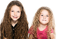 two beautiful caucasian little girls portrait isolated studio on white background