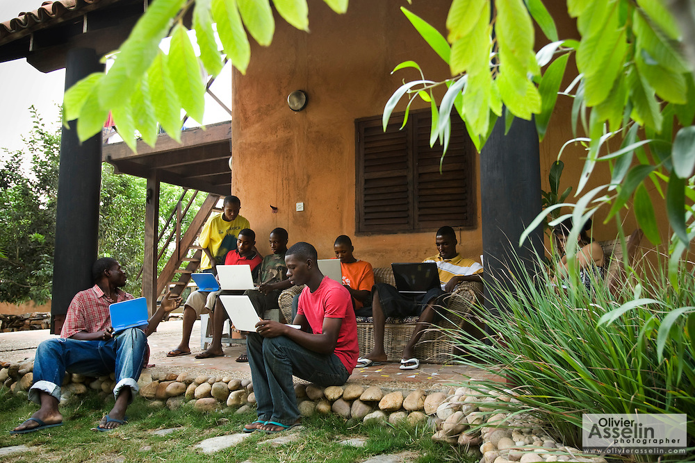 Students use laptops to browse the internet over a wireless network at the Kokrobitey Institute in the town of Kokrobitey, 30km west of Ghana's capital Accra on Sunday January 18, 2009. From left to right Oti Dodoo, Patrick Tetteh Tamatey, Reuben Sekpona, Kenful Agbemenya, Simon Mensah, Abass Aryee, Joshua Sarbah.