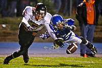 Travis Tackett from Coeur d'Alene High maintains tight coverage while making a play on the ball in front of Post Fall High's receiver Seth Anderson.