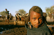 Portrait of Fulani girl, cattle nomads at well in Niger, Africa.