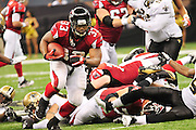 Atlanta Falcons RB Michael Turner powers through the  New Orleans Sainst defense during their game Sunday Sept. 26,2010. The Super Bowl Champions New Orleans Saints play the Atlanta Falcons Sunday Sept 26, 2010 in New Orleans at the Super Dome in Louisiana.  The Saints and Falcons were tied at half time and went into overtime tied 24-24. Hartley missed a kick to win in overtime, the Falcons went on to win in OT with a field goal 27-24. PHOTO©SuziAltman.com
