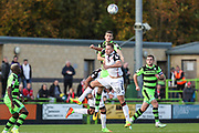 Forest Green Rovers Alexander Iacovitti(20) beats Morecambe's Adam McGurk(28) to a header during the EFL Sky Bet League 2 match between Forest Green Rovers and Morecambe at the New Lawn, Forest Green, United Kingdom on 28 October 2017. Photo by Shane Healey.