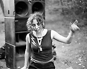 Young Woman Dancing in front of Speakers at Fancy Dress Free Party in Goodwood, Free Party Scene,  Sussex, England 1990s.