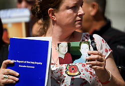 © Licensed to London News Pictures. 06/07/2016. London, UK. SARAH O'CONNOR, whose brother, Sergeant Bob O'Connor died in Iraq, holding a picture of her with her brother and a copy of the Chilcot Report as she leaves the QE2 conference centre in London where the long-awaited Chilcot inquiry into the war in Iraq has been released. Photo credit: Ben Cawthra/LNP