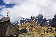 Day 2 of 10: Pause for some boulder climbing in the Huaripampa Valley on the way up Punta Union. Trek 10 days around Alpamayo, in Huascaran National Park (UNESCO World Heritage Site), Cordillera Blanca, Andes Mountains, Peru, South America.