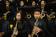 Isabel Li, MHS freshman, left, and Sean Bautista, MHS senior, blow into their Alto Saxes during the Milpitas Unified School District's 11th Annual Music Festival at Milpitas High School in Milpitas, California, on April 10, 2014. (Stan Olszewski/SOSKIphoto)