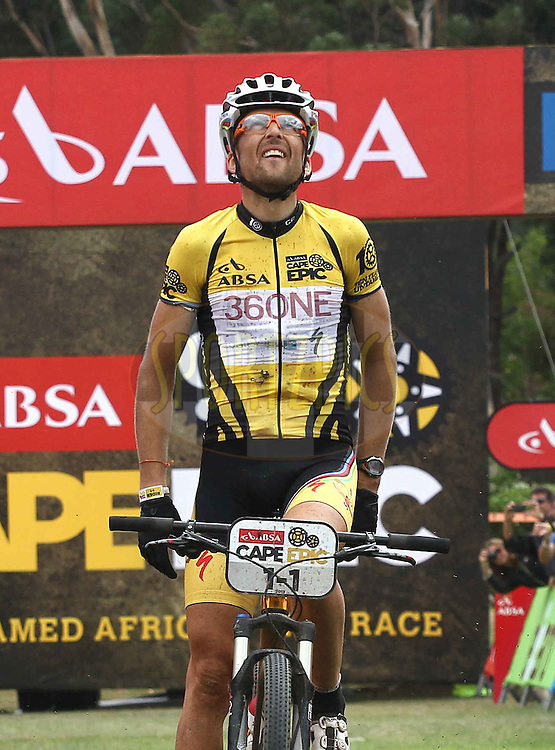 Christoph Sauser of Burry Stander-SONGO looks to the heavens after crossing the line to win the 7th stage with his partner Jaroslav Kulhavy during stage 6 of the 2013 Absa Cape Epic Mountain Bike stage race from Wellington to Stellenbosch, South Africa on the 23 March 2013..Photo by Shaun Roy/Cape Epic/SPORTZPICS