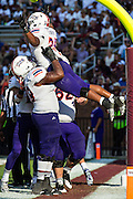 STARKVILLE, MS - SEPTEMBER 19:  De'Mard Llorens #25 of the Northwestern State Demons is lifted in the air by a teammate after scoring a touchdown against the Mississippi State Bulldogs at Davis Wade Stadium on September 19, 2015 in Starkville, Mississippi.  The Bulldogs defeated the Demons 62-13.  (Photo by Wesley Hitt/Getty Images) *** Local Caption *** De'Mard Llorens