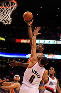 Mar. 21 2010; Phoenix, AZ, USA; Phoenix Suns forward Amare Stoudemire (1) puts up a shot against Portland Trailblazers forward Juwan Howard (6) in the second half at the US Airways Center. The Suns defeated the Trail Blazers 93 to 87. Mandatory Credit: Jennifer Stewart-US PRESSWIRE.