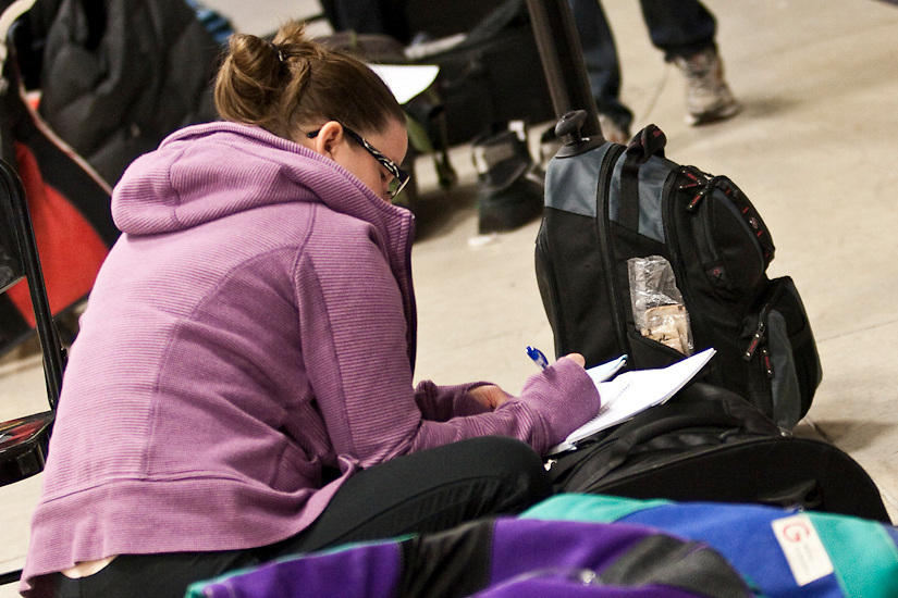 A student takes notes after a morning of target shooting and instruction.