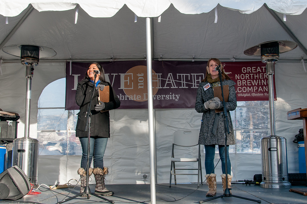 (L to R) Love Not Hate organizers and Whitefish, MT, residents Dominca Kau'ano Cleveras and Jessica Loti Laferriere welcoming the crowd and introducing the speakers at Love Not Hate.