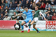 Chris Hussey and Georhe Cooper during the EFL Sky Bet League 2 match between Plymouth Argyle and Cheltenham Town at Home Park, Plymouth, England on 21 September 2019.