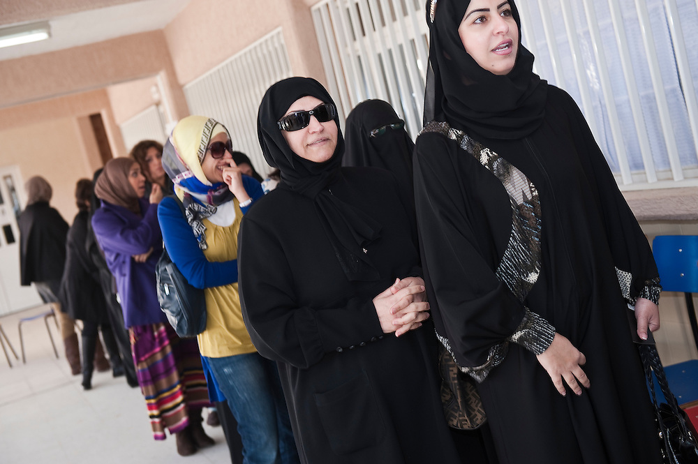 Kuwaiti women voters queue up at a polling station in Kuwait City to vote in the country's February 2 parliamentary elections. A total of 400,296 Kuwaiti men and women are eligible to cast ballots to choose from among some 285 candidates, including more than 20 women candidates, for a new 50-seat parliament.