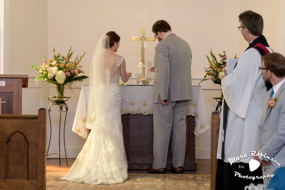 bride and groom lighting the unity candle by Tallmadge wedding photographer, Akron wedding photographer Mara Robinson Photography