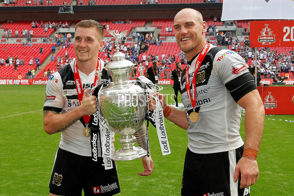 Jamie Shaul and Gareth Ellis show off the cup after the Challenge Cup Final 2016 match between Warrington Wolves and Hull FC at Wembley Stadium, London, England on 27 August 2016. Photo by Craig Galloway.