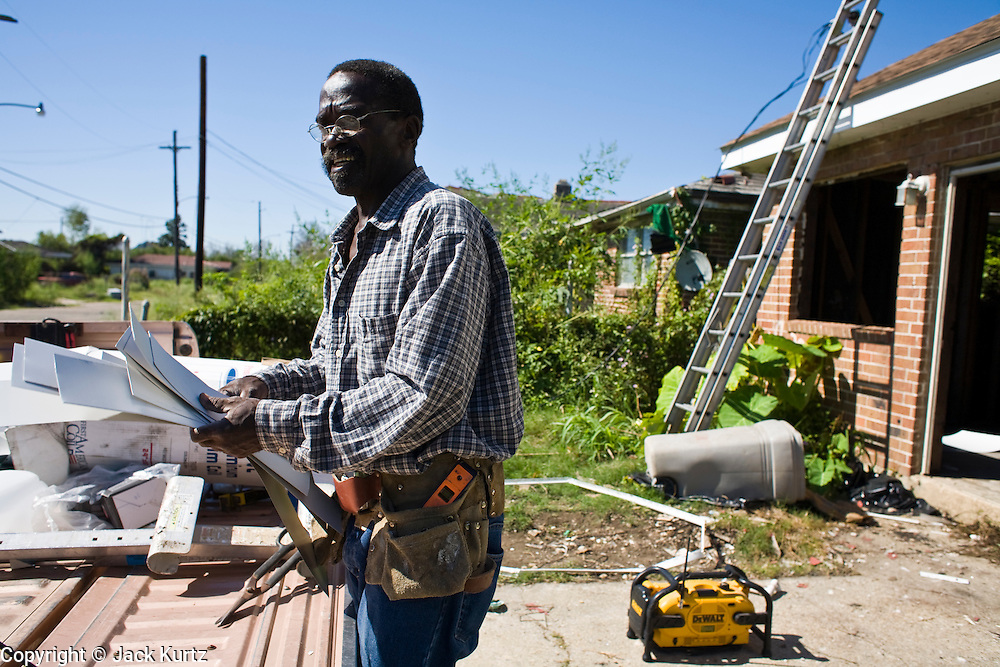 20 SEPTEMBER 2006 - NEW ORLEANS, LOUISIANA: ROGER MCCLARY, a construction worker from Slidell, LA, works on restoring a home in the Lower 9th Ward of New Orleans, LA. The neighborhood was abandoned after flooding from nearby canals after Hurricane Katrina inundated this part of the city. Photo by Jack Kurtz / ZUMA Press
