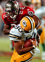 Tampa Bay Bucs #22 Charles Mincy  tackles GB wide receiver #80 Derrick Mayes in the 3rd quarter, 12/7/98.