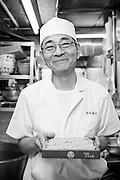 Chef Katsuzo Sugai with soba noodles in the kitchen of the Sarashina Horii Restaurant. Katsuzo Sugai is 62 years old and has worked at the restaurant for 25 years. Tokyo, Japan.