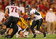 September 2 2010: Northern Illinois Huskies quarterback DeMarcus Grady (3) looks for running room during the first half of the NCAA football game between the Northern Illinois Huskies and the Iowa State Cyclones at Jack Trice Stadium in Ames, Iowa on Thursday September 2, 2010.