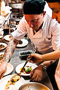 Head chef plating in the kitchen at M on the Bund.