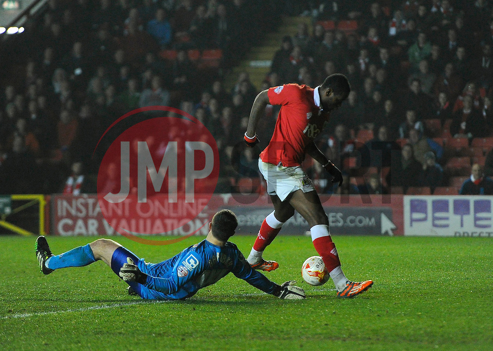 Bristol City's Jay Emmanuel-Thomas takes the ball around Crewe Alexandra's Paul Rachubka to score  - Photo mandatory by-line: Joe Meredith/JMP - Mobile: 07966 386802 - 17/03/2015 - SPORT - Football - Bristol - Ashton Gate - Bristol City v Crewe Alexandra - Sky Bet League One