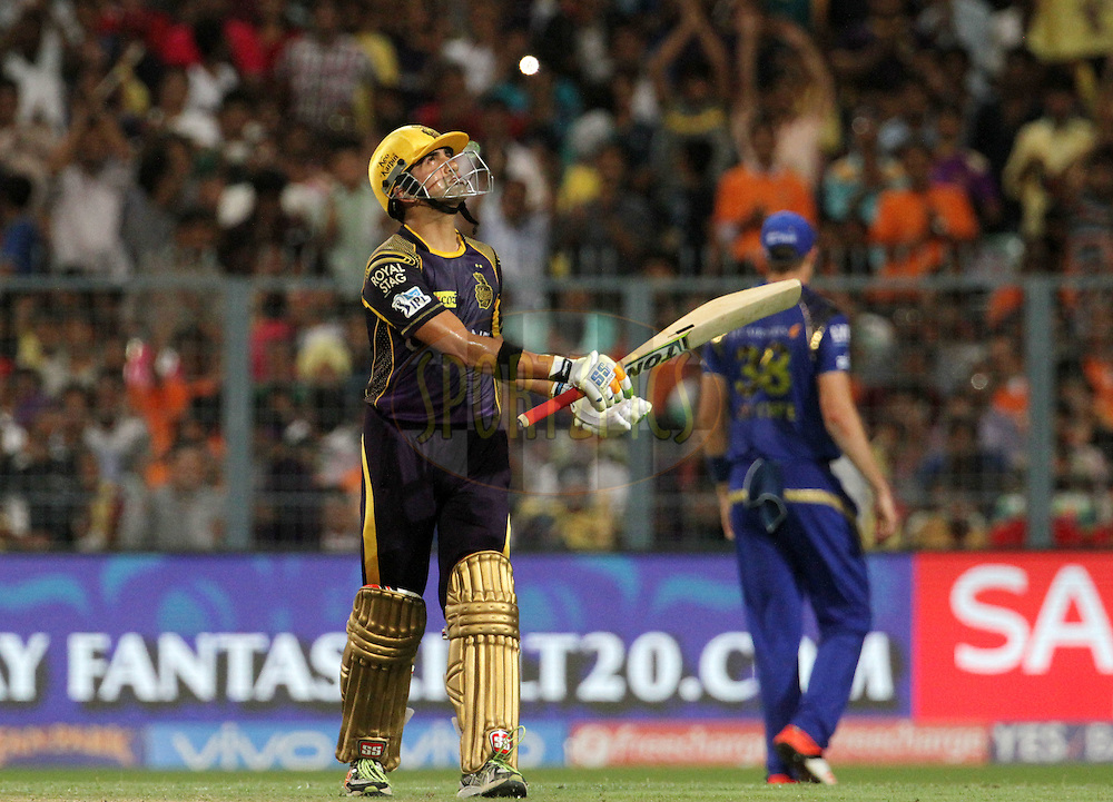 Kolkata Knight Riders captain Gautam Gambhir raises his bat after scoring a fifty during match 5 of the Vivo Indian Premier League ( IPL ) 2016 between the Kolkata Knight Riders and the Mumbai Indians held at the Eden Gardens Stadium in Kolkata on the 13th April 2016<br /> <br /> Photo by Vipin Pawar/ IPL/ SPORTZPICS
